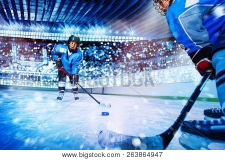 Ice Hockey Player Passing The Puck To Teammate