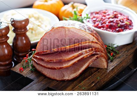 Holiday Glazed Sliced Ham On Dinner Table For Thanksgiving Or Christmas