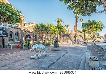 Cape Town, South Africa, August 9, 2018: A Scene, With A Multi-colored Rhino Statue, At The Victoria