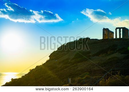 Greece Cape Sounion. Ruins Of An Ancient Temple Of Poseidon, Greek God Of The Sea, At Sunset. Travel