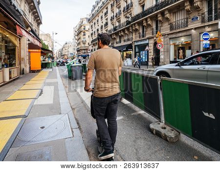 Paris, France - Oct 13, 2018: Man On Electric Scooter Commuting In Central Paris