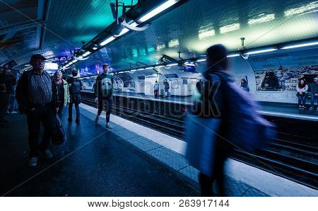 Paris, France - Oct 13, 2018: Blue Color Cast Over Commuters Large Crowd Of People Waiting In The Mo