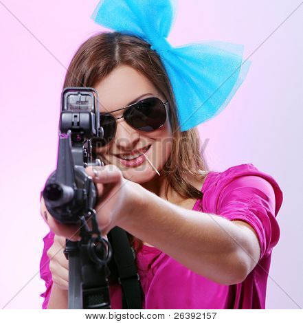 Attractive and sexy spy woman with assault rifle on white background
