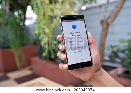 Chiang Mai, Thailand - August 05,2018: Man  Holding Huawei With Facebook Messenger App On Screen.fac