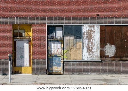 urban storefront in an old part of town, abandoned and in disrepair