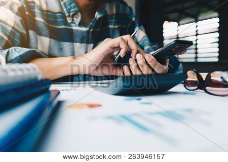 Businessman Or Accountant Using Smartphone Working About Financial Document Data.accounting -tax Doc