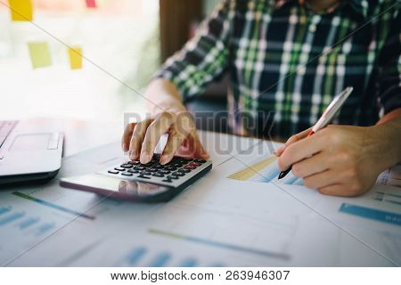 Businessman Using Calculator Analyze Report At Office.  Hand Of Businessman Working Financial Report