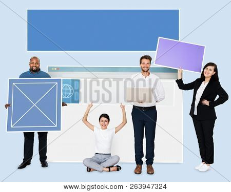 Happy diverse people holding web design board