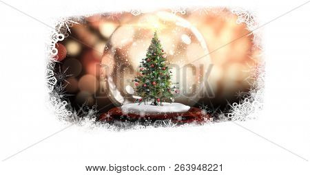 Digital composite of Christmas snowflake border with Christmas tree in snow globe