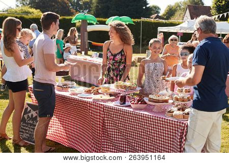 Busy Cake Stall At Summer Garden Fete