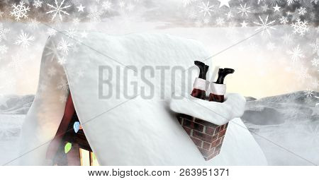 Digital composite of Santa stuck in chimney in Winter snow