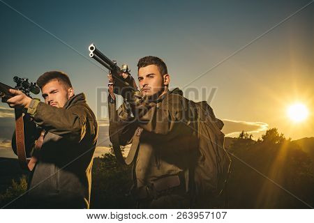 Hunting gun. Hunter aiming rifle in forest. Calibers of hunting rifles. Hunter with shotgun gun on hunt. Hunter in the fall hunting season poster
