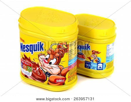 Novyy Urengoy, Russia - October 18, 2018: Yellow Cans Of The Nestle Nesquik Cocoa Isolated Over Whit