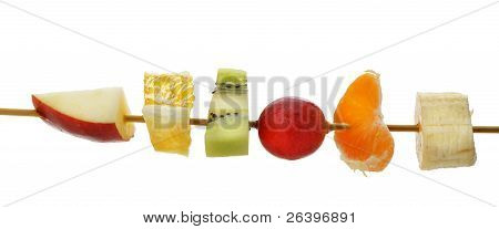 Segmente der Frucht auf einem Holzstab
