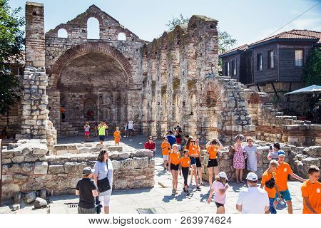 21 August 2018 Unidentified People Walk Near The Ruins In The Old Town, Background Image, Nessebar,