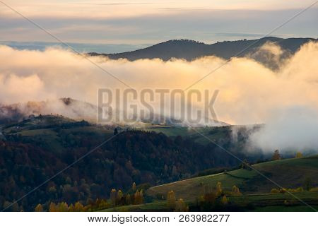 Cloud Inversion At Dawn. Lovely Autumn Scenery Of Mountainous Rural Area