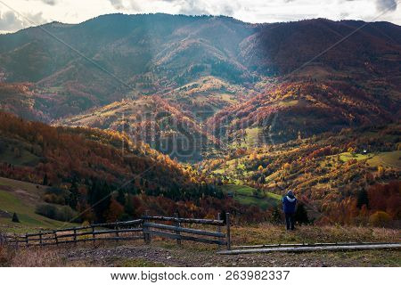 Undefined Person On The Edge Of A Hill Looking In To The Distant Rural Valley. Beautiful Nature Scen