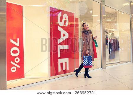 Woman In Shopping. Happy Woman With Shopping Bags Enjoying In Shopping. Consumerism, Shopping, Lifes