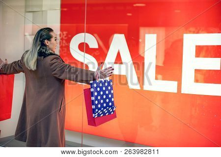 Big Sale- Consumerism, Shopping, Lifestyle Concept Woman In Shopping. Happy Woman With Shopping Bags