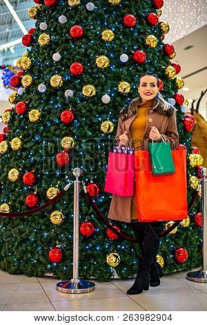 Consumerism, Christmas, Shopping, Lifestyle Concept Woman In Shopping. Happy Woman With Shopping Bag