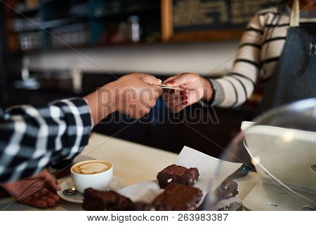 Cafe Customer Paying For An Order With Her Credit Card