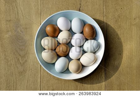 A Bowl Of Chicken Eggs Of Different Colours Seen From Above