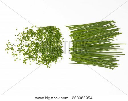Chopped And Whole Chives On A White Background