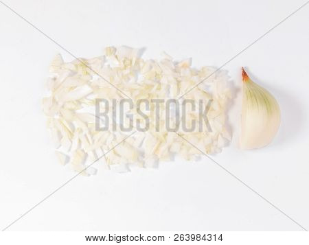 A Half A Peeled Onion And Diced Onion On A White Background