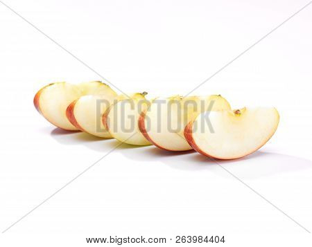 Five Pieces Of Sliced Apple On A White Background