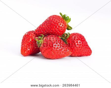 A Pile Of Strawberrys On A White Background
