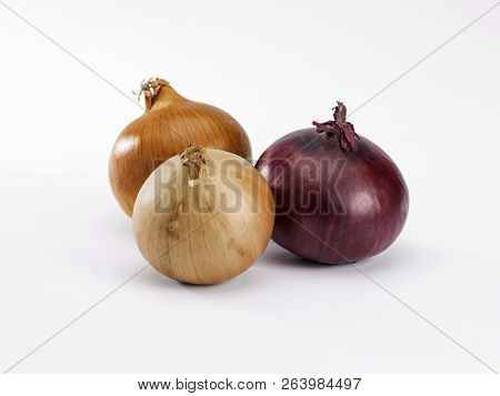 Three Red And White Onions On A White Background