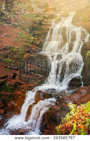 Waterfall Shypot In Gorgeous Evening Light. Beautiful Autumn Scenery Of Carpathian Nature Wonders