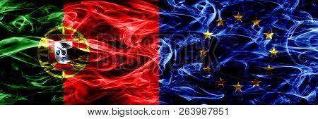 Portugal Vs European Union, Eu Smoke Flags Placed Side By Side. Thick Colored Silky Smoke Flags Of P