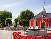 Stavern townscape with World War II Memorial fountain made of local granite and renaissance baroque Stavern church. Stavern is a popular travel destination on the Southern Norway seacoast poster