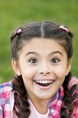 Cute surprised girl with smile on her face. Expression of happiness. Moment of unexpectancy. Looking forward to present. Beautiful young face. Bright emotion on lady face. poster