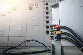 Electrical substation room in petrochemical industry or Oil and gas refinery and power plants, Switchgear or beaker with wire connect concept poster