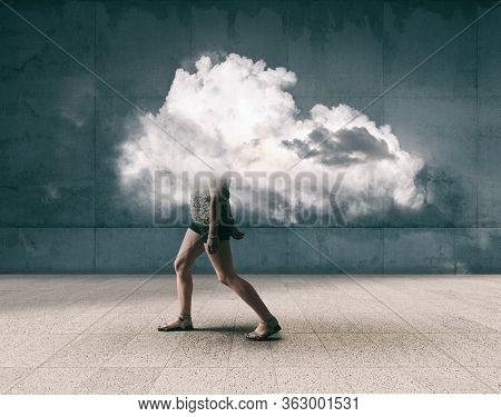 Woman Walking Outdoor With The Head Inside A Cloud . Mental Illness Concept.
