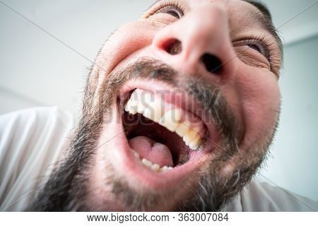 Extreme close up portrait of funny laughing man