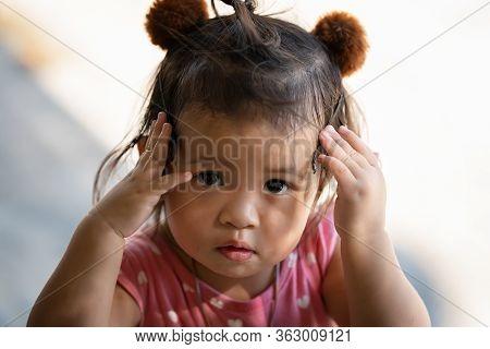Closeup Portrait Of A Cute Little Thai Girl Thinking, Close Up Portrait Of A Cute Little Girl