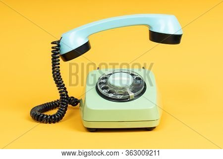 Old Telephone On Yellow Background. Vintage Phone With Taken Off Receiver