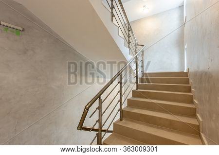 Modern Stair Case Between Floors. Stairs With Metallic Rail  In Modern Building