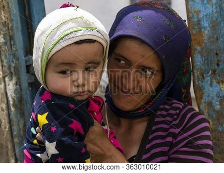 Wakhan, Tajikistan - June 20, 2020: Mother And Child In The Wakhan Valley At The Pamir Highway In Ta