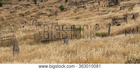 Osh, Kyrgyzstan - June29, 2019: The Graveyard With Graves On The Slope Of A Hill In The Village Of O