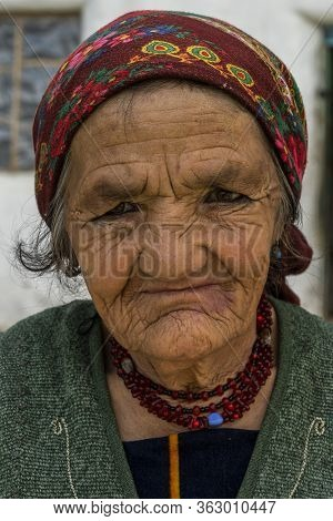 Wakhan, Tajikistan - June 20, 2020: Portrait Of An Old Woman In Traditional Clothes In The Wakhan Va
