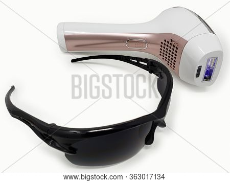 At home do it yourself permanent laser hair remover and safety glasses with Clipping Path.