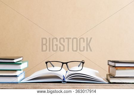 Books And Textbook On Wooden Desk In Library Selective Focus , Piles Of Books On Reading Desk In Sch
