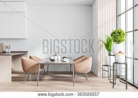Interior Of Stylish Dining Room With White And Wooden Walls, Wooden Floor, Long Dining Table With Be