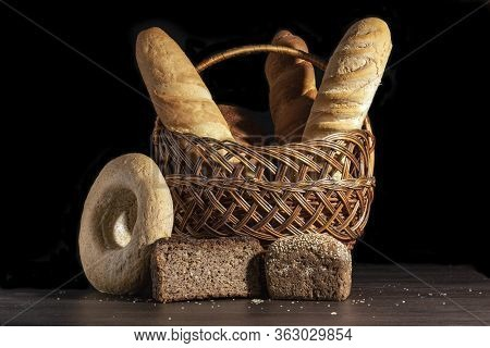 Freshly Baked Wheat Bread, Still Life With Bread, Crisp Loaf Of Bread, Still Life On A Rustic Backgr