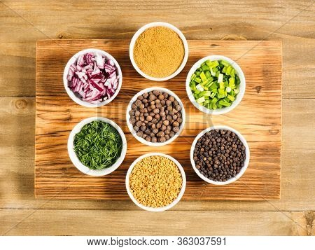 Spice Black Pepper, Fenugreek, Masala, Allspice, Chopped Red Onion, Green Onion, Fennel In White Bow