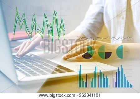 Forex Trading. Woman Working With Laptop At Table And Charts, Closeup